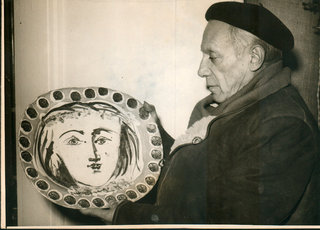 Picasso holding a large ceramic plate by Pablo Picasso