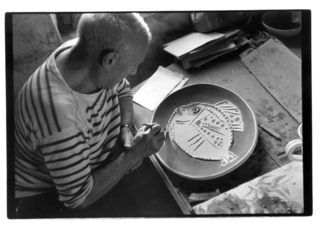 """Picassso painting a large """"Fish Dish"""" by Pablo Picasso"""