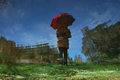 The woman's red umbrella II by Brandan
