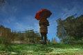 The woman's red umbrella II by Brandan