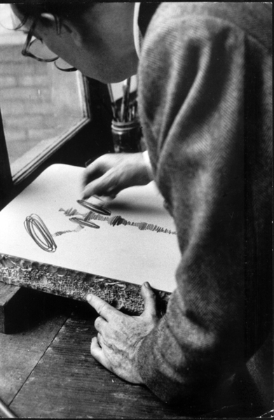 Dali works at a lithography stone in the Atelier Mourlot by Salvador Dalí