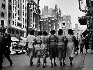 Ladies Walking Along Gran Vía, Madrid, Spain. by Francesc Catalá Roca