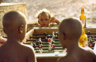 Girl & Table Soccer, Africa by Anya Bartels-Suermondt