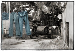 Drying Denim (Near Playa Ancon, Cuba. Early Morning) by Joe Lasky