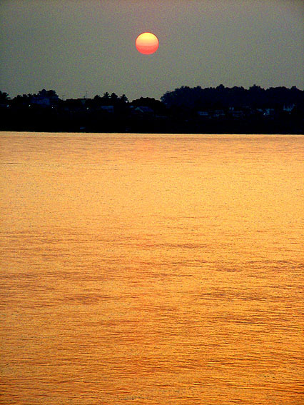 Amber Light on Mekong by Martin Collins