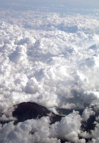 Volcano in the Clouds by Rubén García Martínez