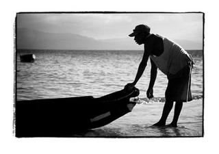The Young Kuna and his Dugout Canoe by Joe Lasky
